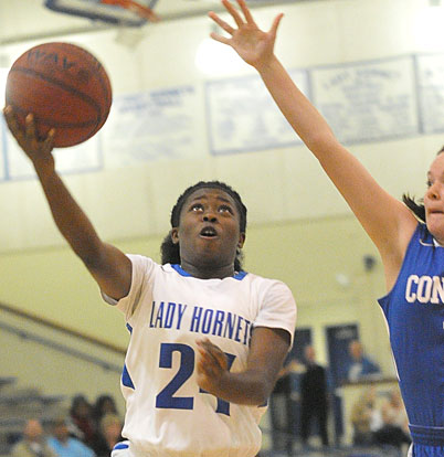 Kali Walker tries to get a shot around a Conway Blue defender. (Photo by Kevin Nagle)