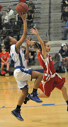 Jaiyah Jackson avoids a Cabot South defender on the way to the basket. (Photo by Kevin Nagle)