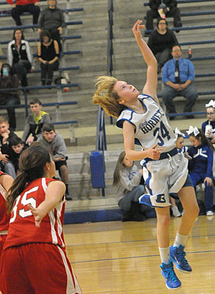 Kaitlyn Weng (34) goes up for a layup. (Photo by Kevin Nagle)
