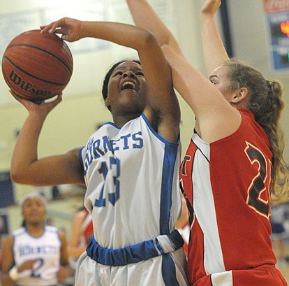 Selena Martin (13) powers up a shot over a Cabot defender. (Photo by Kevin Nagle)