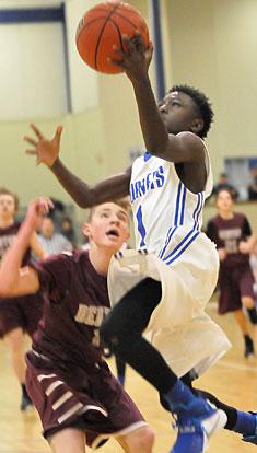 Tre'Vun Herron drives to the basket. (Photo by Kevin Nagle)