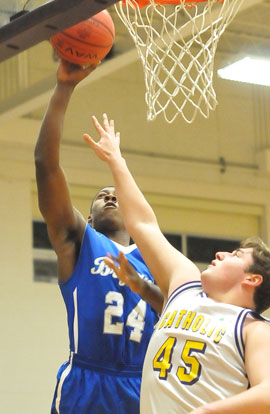 Bryant's Marvin Moody (24) goes up for a shot over Little Rock Catholic's Jack Mathis. (Photo by Kevin Nagle)