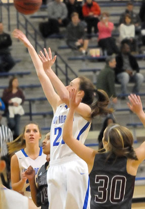 Mary Catherine Selig puts up a shot in the lane. (Photo by Kevin Nagle)