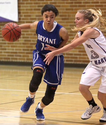 Raija Todd looks to drive around Mount defender Conley Norris (23). (Photos by Rick Nation)