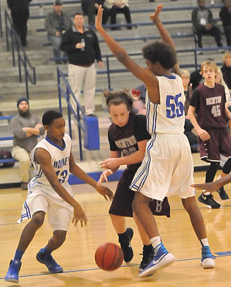 Derrick Rose and Catrell Wallace (55) trap Benton's Jaden Woolbright. (Photo by Kevin Nagle)