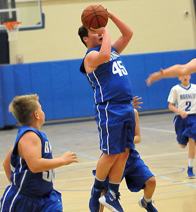 Bryant White's Chandler Stewart (45) sets to launch a shot. (Photo by Kevin Nagle)