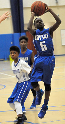 Bryant White's Kaylon Thurston takes a shot off a drive into the lane as Bryant Blue's Brandon Weems blocks out. (Photo by Kevin Nagle)