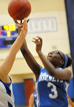 Sierra Trotter attempts a shot for Bryant White. (Photo by Kevin Nagle)