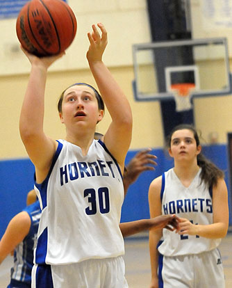 Bryant Blue's Cali Rogers (30) eyes a free throw as teammate Natalie Harllee (24) looks on. (photo by Kevin Nagle)