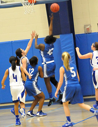 Bryant White's MeKeycia Baker goes up for a lay-in. (Photo by Kevin Nagle)