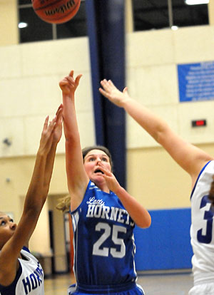 Bryant White's Madalynn Thompson launches a shot in traffic. (Photo by Kevin Nagle)