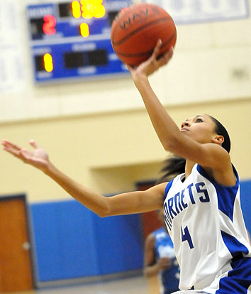 Bryant Blue's Jada Deaton finishes off a drive to the hoop. (Photo by Kevin Nagle)