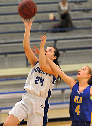 Natalie Harllee (24) goes up for a lay-in. (Photo by Kevin Nagle)