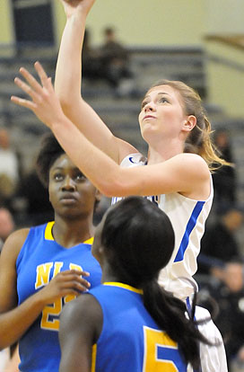 Meagan Chism goes up for a shot in traffic. (Photo by Kevin Nagle)