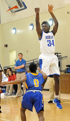 Randy Thomas releases a shot from the 3-point line. (Photo by Kevin Nagle)