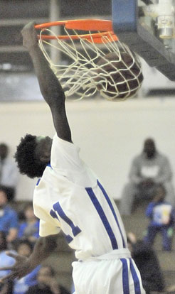 Kevin Hunt finishes off a drive with a dunk. (Photo by Kevin Nagle)