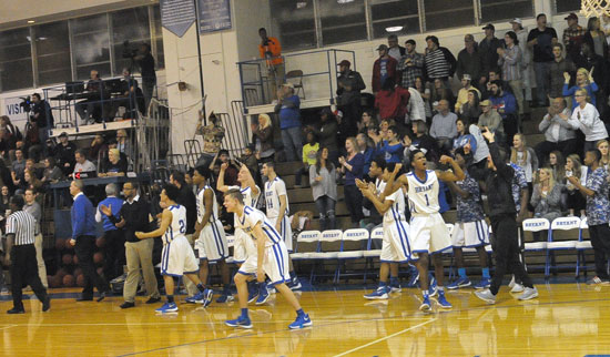 Bryant's bench celebrates the 54-53 victory as the buzzer ends Tuesday's game. (Photo by Kevin Nagle)