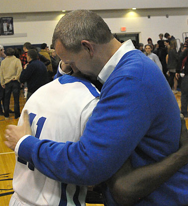 Senior Kevin Hunt and Bryant coach Mike Abrahamson hug after Tuesday's Saline County Shootout win. (Photo by Kevin Nagle)