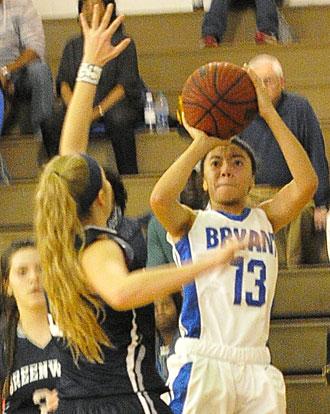 Raija Todd (13) eyes the basket. (Photo by Kevin Nagle)