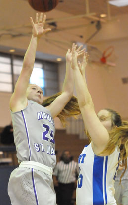 Anna Turpin, right, defends against Mount St. Mary's Anna Crawford. (Photo by Kevin Nagle)