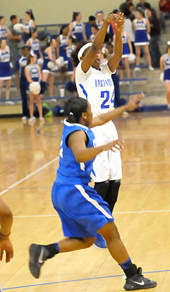 Kalia Walker fires up a jump shot. (Photo by Kevin Nagle)