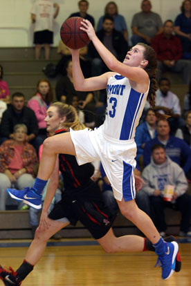 Kendal Rogers attacks the basket. (Photo by Rick Nation)