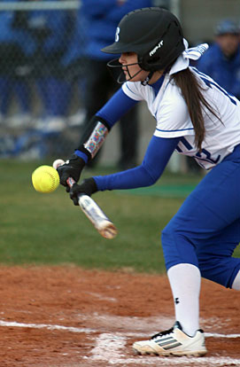 Maddie Stephens gets a bunt down during Thursday's game. (Photo by Rick Nation)