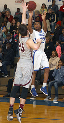 Romen Martin (33) lets a 3-point shot fly over Siloam Springs defender Carlson Wakefield (25). (Photo by Rick Nation)