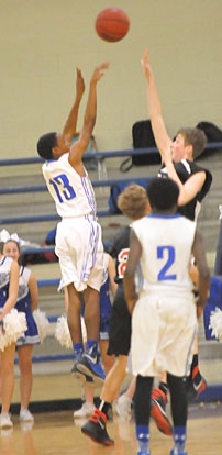 Darrick Rose (13) fires a shot over a Russellville defender. (Photo by Kevin Nagle)