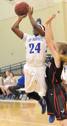 Kalia Walker (24) goes up in traffic to try to get a shot away. (Photo by Kevin Nagle)