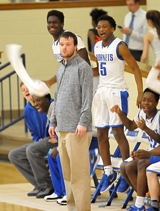 Coach Tyler Posey and the Bryant bench watch the action. (Photo by Kevin Nagle)