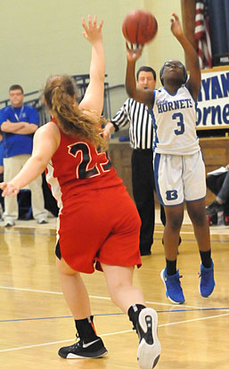 Sierra Trotter (3) fires up a jumper from the wing. (Photo by Kevin Nagle)