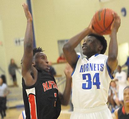 Randy Thomas (34) eyes the basket. (Photo by Kevin Nagle)