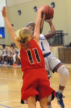 Tierra Trotter (1) tries to finish a drive to the basket. (Photo by Kevin Nagle)