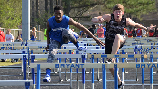 Bryant's Mondale Messer (left) battles Bauxite's Tyler Wilson during Tuesday's meet. (Photo courtesy of Julie Shelby)