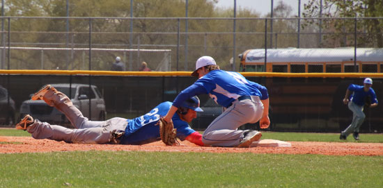 Aaron Orender applies a tag at first on a pick-off play.