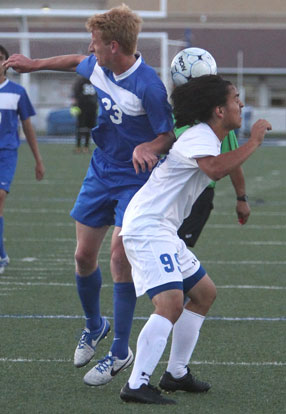 Martin Ramierez (99) battles a Conway player for control of the ball. (Photo by Rick Nation)