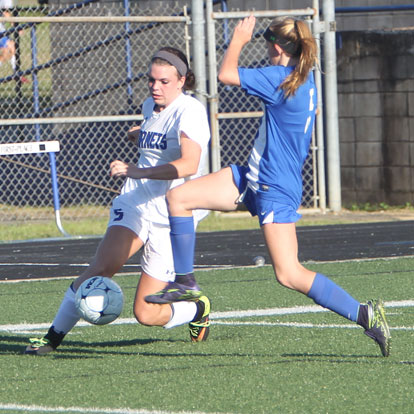 Kendall Selig works to control the ball against a Conway defender. (Photo by Rick Nation)