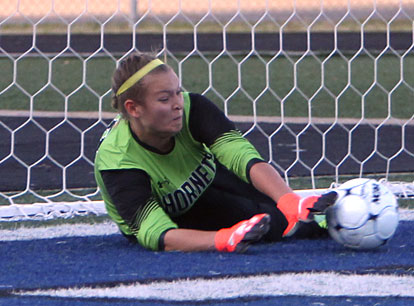 Keeper Brittney Warner stops a Conway penalty kick during Thursday night's shootout. (Photo by Rick Nation)