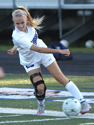 Maddie Hubbard maneuvers to dribble past a defender. (Photo by Rick Nation)