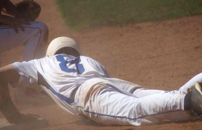 Aaron Orender clings to third base after sliding in safely on a close play. (Photo courtesy of Paul Dotson)