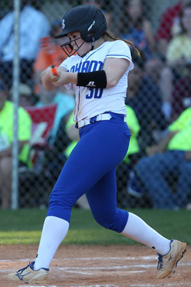 Brooklyn Trammell follows through on her home-run swing in the top of the seventh. (Photo by Rick Nation)