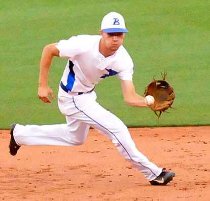 Shortstop Jake East ranges to his left to make a play. (Photo by Kevin Nagle)
