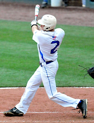 Evan Lee follows through on his two-run homer in the bottom of the fifth. (Photo by Kevin Nagle)