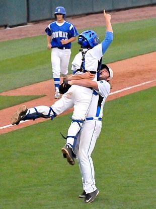 Catcher Dylan Hurt leaps into the arms of pitcher Zach Jackson to start Bryant's State championship celebration. (Photo by Kevin Nagle)
