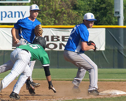 Pitcher Evan Lee, right, clips first base with his toe after taking a toss from first baseman Aaron Orender, left, to retire Van Buren's Landry Wilkerson. (Photo courtesy of Paul Dotson)