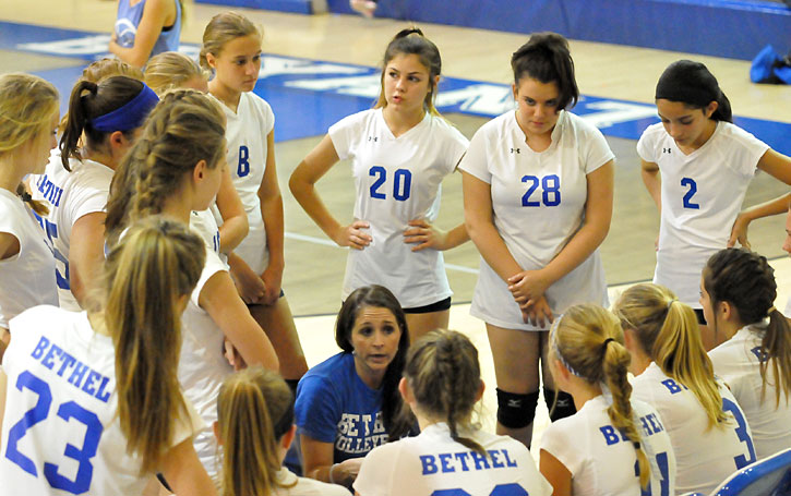 Bethel coach Melissa Bragg meets with her team during a timeout in Monday's action. (Photo by Kevin Nagle)