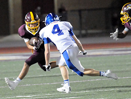 Collin Welch (4) tracks Lake Hamilton's wingback Jacob Nichols. (Photo by Kevin Nagle)