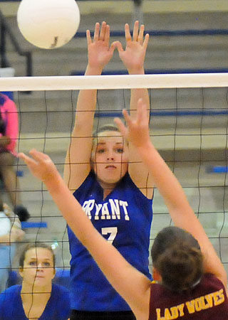 Cora Edwards reaches for a block. (Photo by Kevin Nagle)
