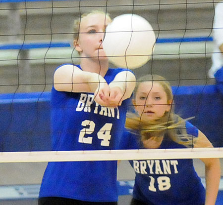 Camille Rawls (24) receives a serve in front of teammate Casey Welch. (Photo by Kevin Nagle)